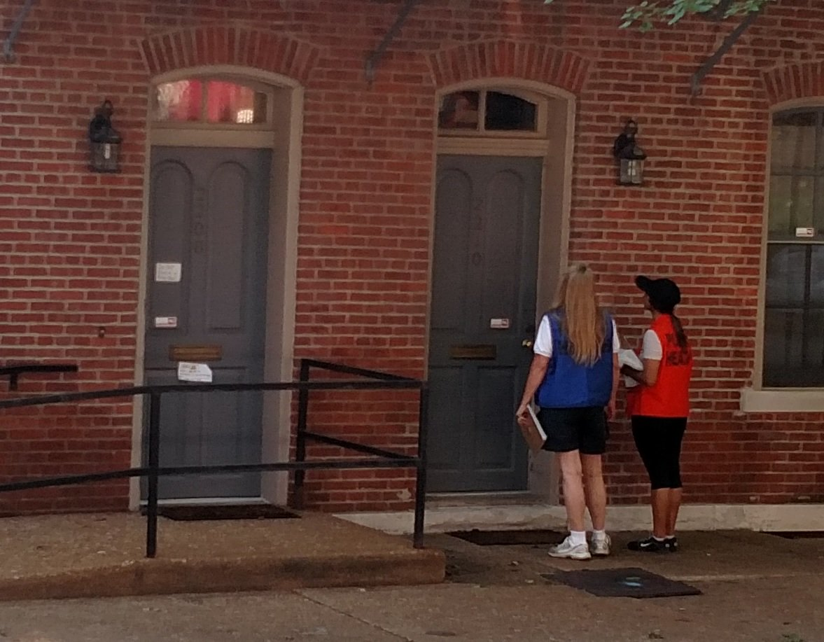 City of St. Louis Department of Health employees go door to door during the heatwave to check on vulnerable residents.