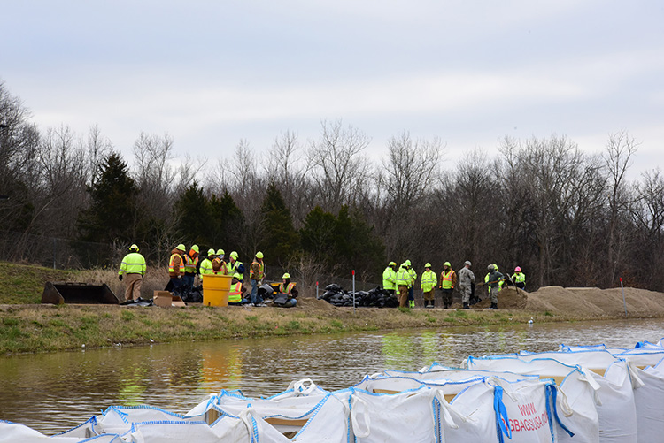 Combat Engineers with the 220th, 880th and 1138th Engineering Companies fill sandbags supporting Missouri Department of Transportation workers in Arnold, Mo