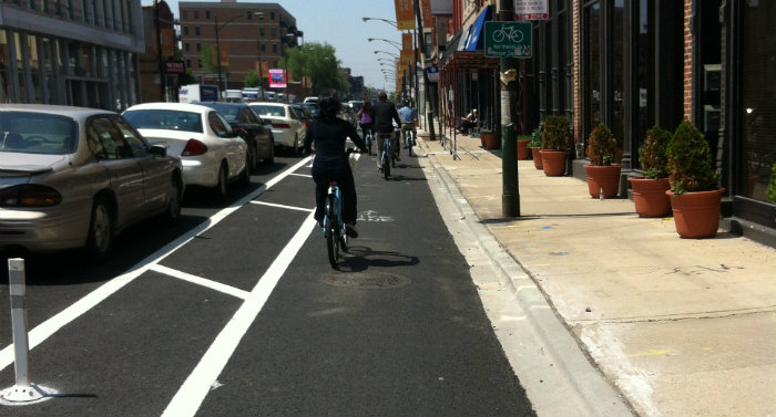 Example Parking Protected Bike Lane and cyclists