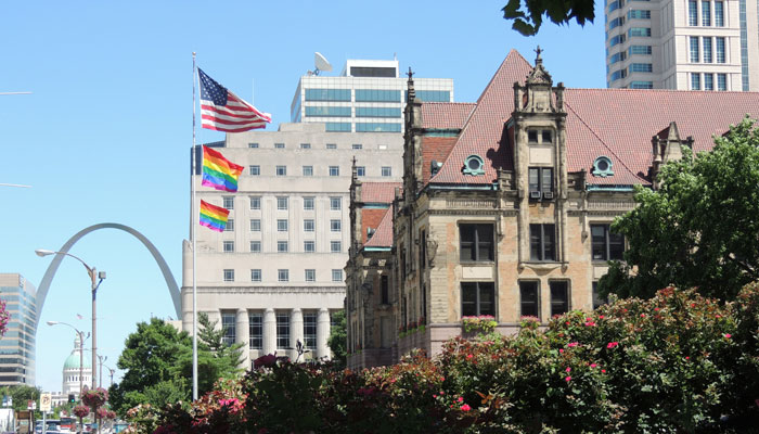 Pride-flags-over-city-hall-and-arch
