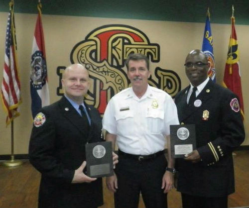Fire Chief Dennis Jenkerson (c) with Firemark Award recipients Firefighter Shawn Bittle (l) and Fire Captain Larry Conley.