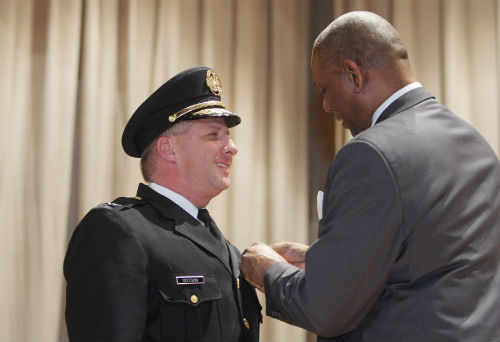 Police Chief Sam Dotson receives his badge at a ceremony on Jan. 31, 2013.