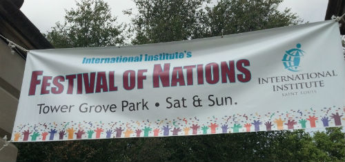Festival of Nations banner at the Grand and Arsenal entrance to Tower Grove Park.