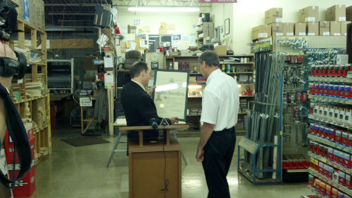 Mayor Slay presents a proclamation to John Edele from Edele and Mertz Hardware on June 6, 2012, the 100th anniversary of the business.
