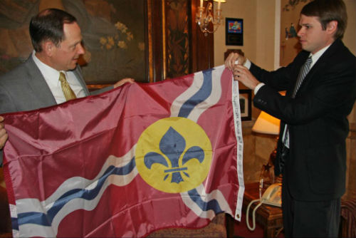 Mayor Francis G. Slay receives a City flag from WashU Engineer Richard Bose on Wednesday, June 5, 2013.