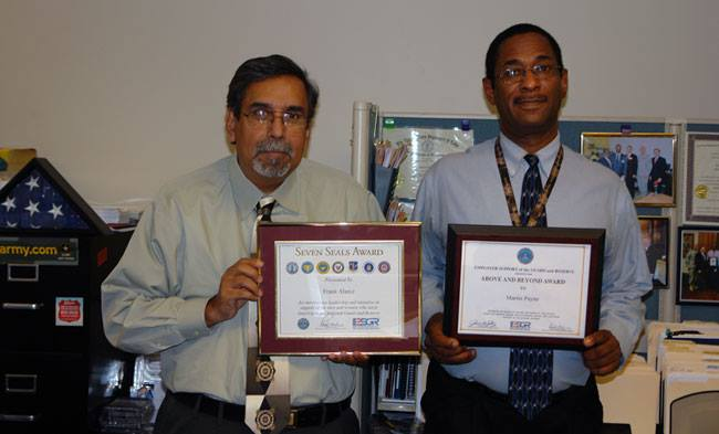 SLATE's Frank Alainz and Marin Payne with ESGR awards