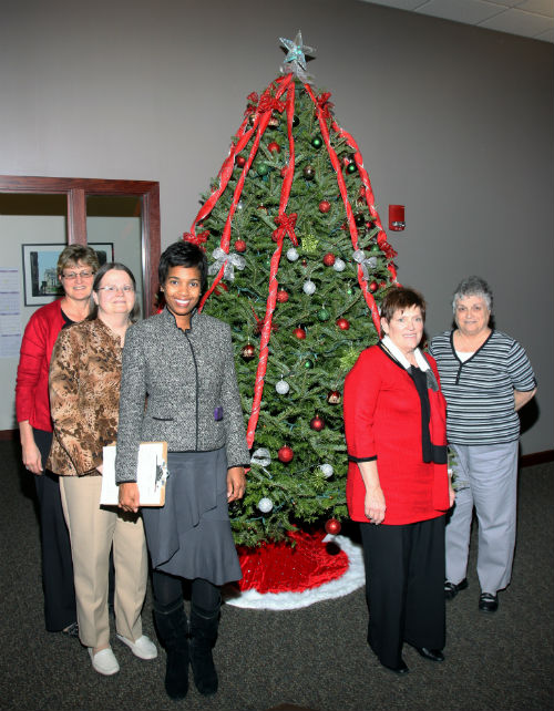 COR employees and contest judges pose by The Big Behemoth entry in the 2012 Tree Decorating Contest.