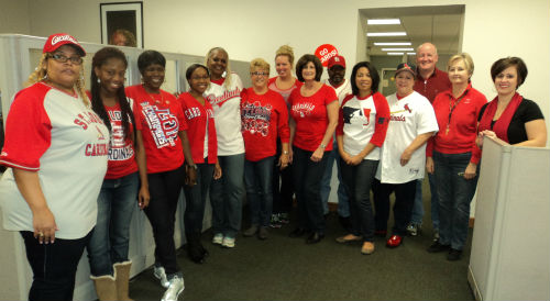 Collector of Revenue Earnings Tax Division employees show their support for the St. Louis Cardinals during their race for the World Series title.