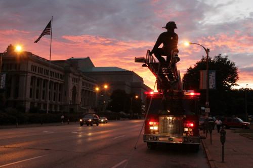 Preparing to raise an American flag at the Firefighters Candlelight Vigil on Sept. 8, 2011.