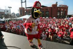 Fredbird leads Cardinals fans during a pep rally in 2014.