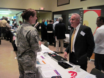 Unisys representative discusses employment opportunities with a veteran