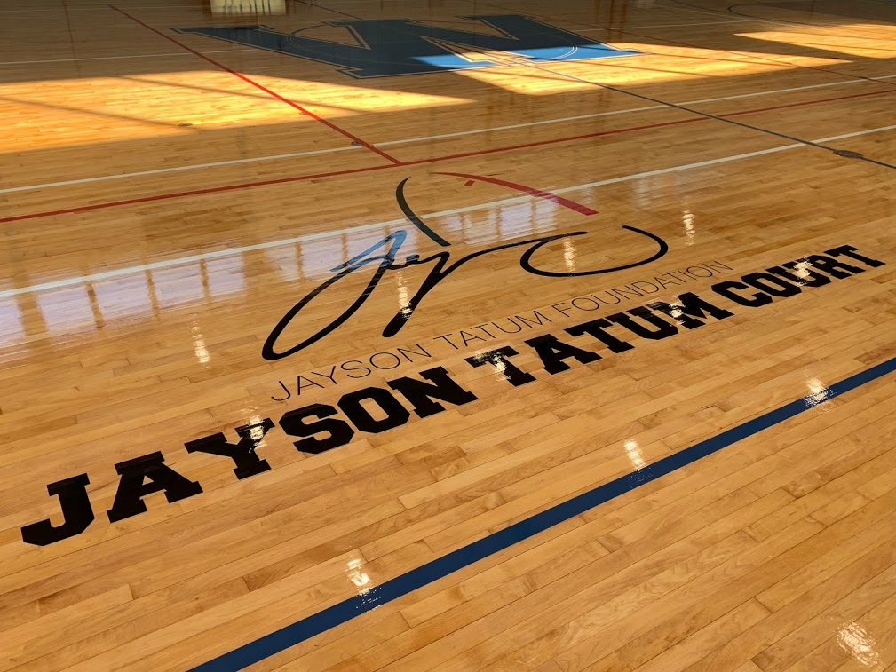 New logo on the floor at Wohl Center