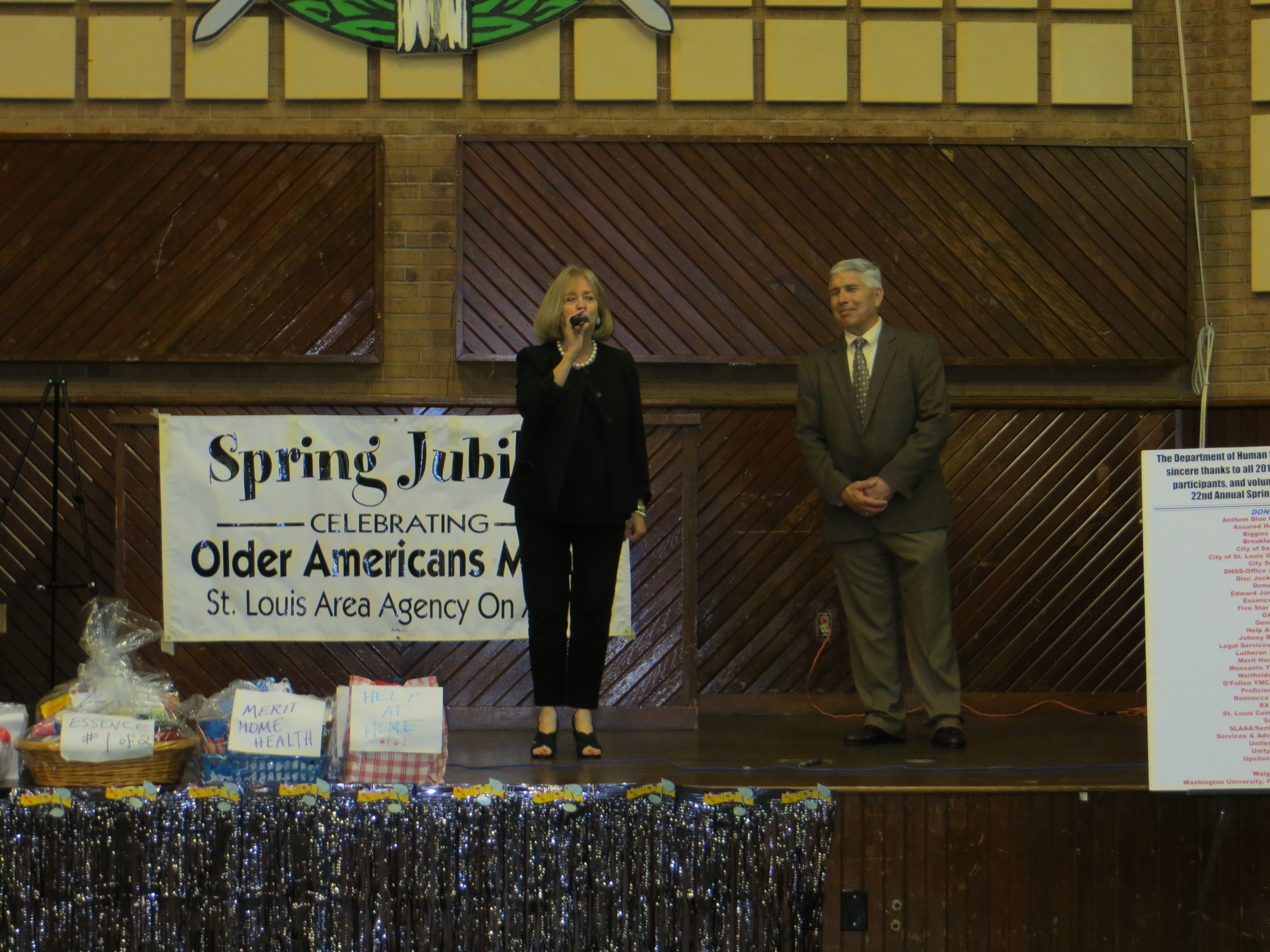 David Sykora of the St. Louis Area Agency on Aging looks on as Mayor Lyda Krewson addresses the audience at the annual Spring Jubilee.