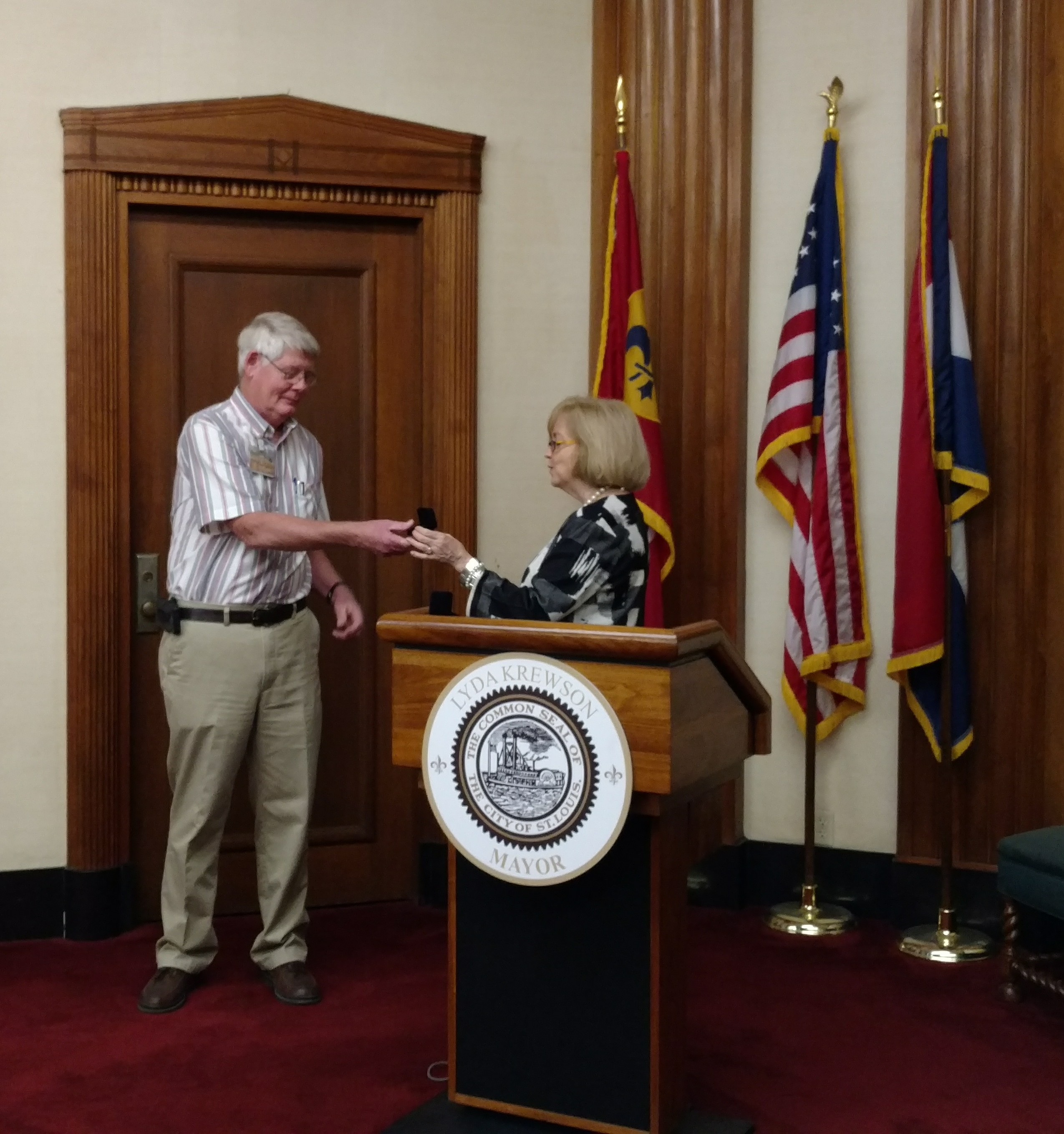 Tom Huelman receives his 40-year service pin from Mayor Lyda Krewson