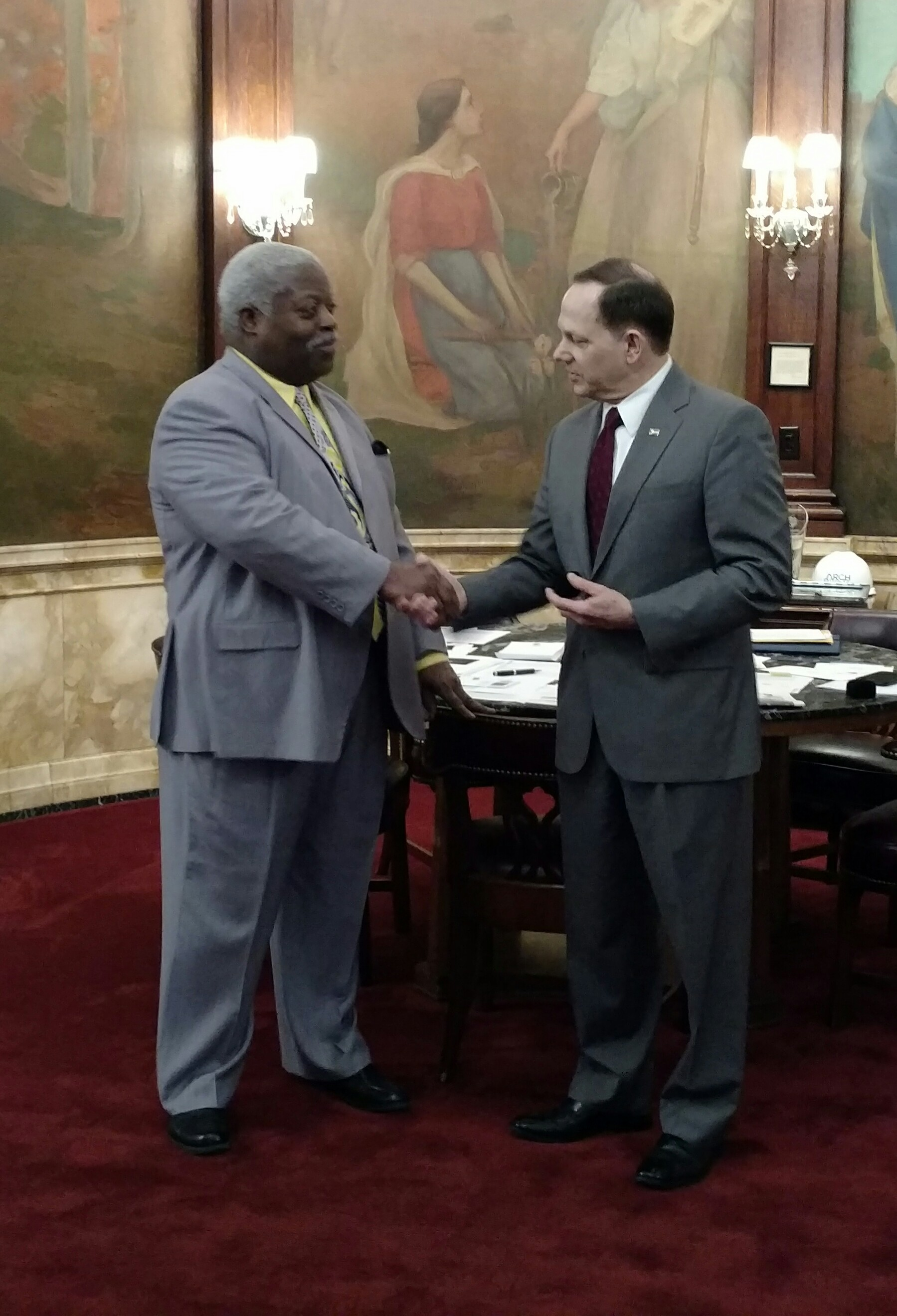 Mayor Francis Slay congratulates Robert Cotton on his 40 years of service with the City.