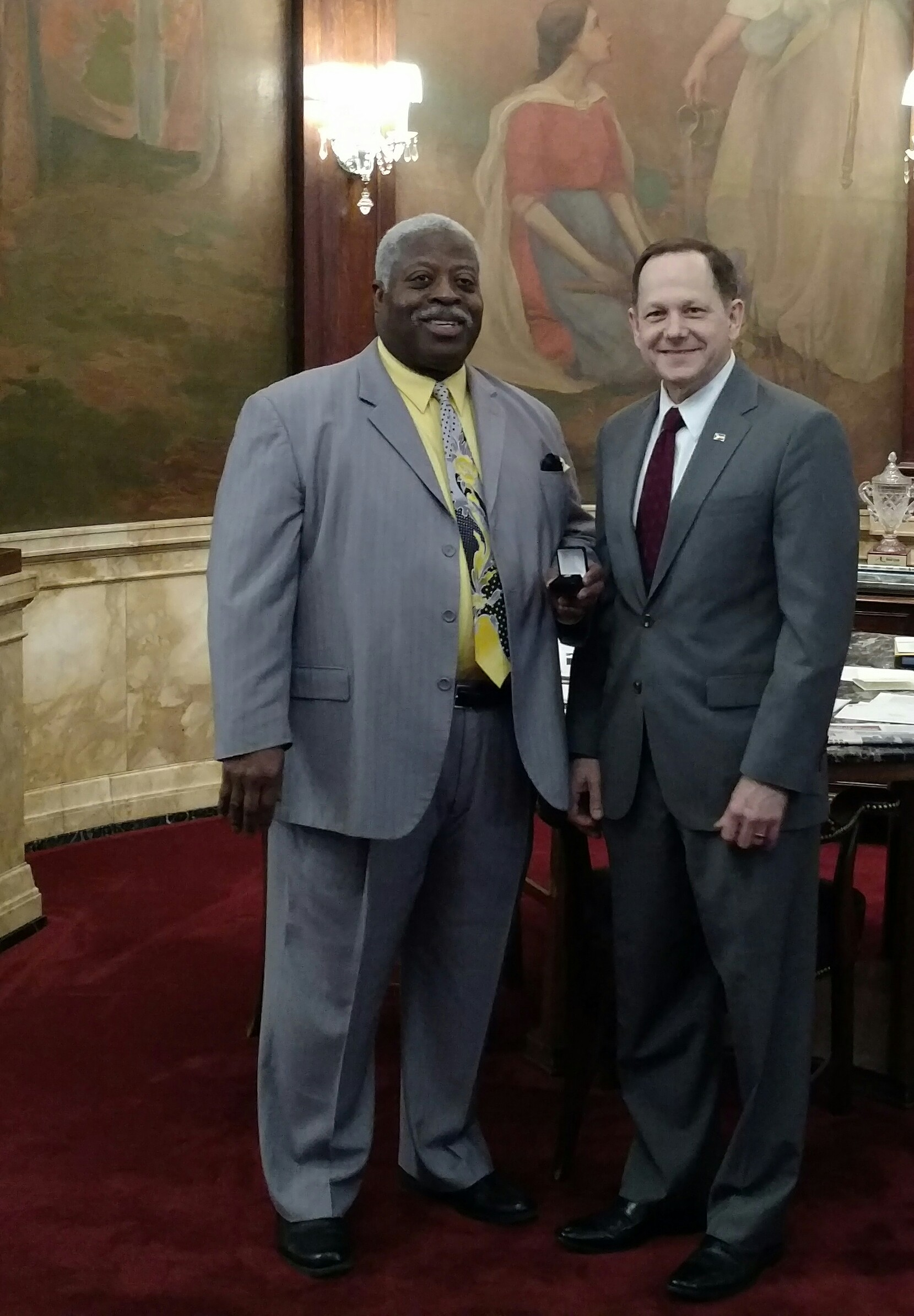 Robert Cotton receives his 40-year service pin from Mayor Francis Slay