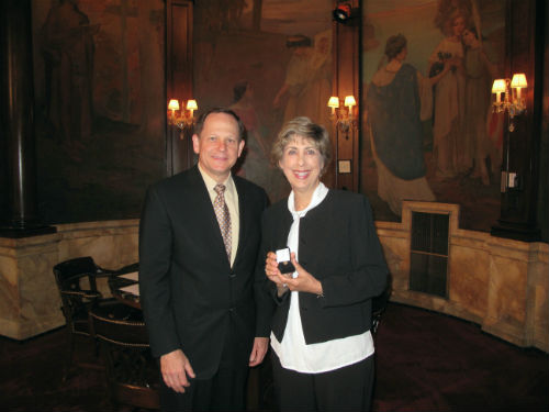Donna Hlavaty receives her 40-year service pin from Mayor Francis G. Slay on April 19, 2013.