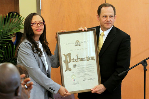 April Ford Griffin receives the Fair Housing Month proclamation from Mayor Francis G. Slay.