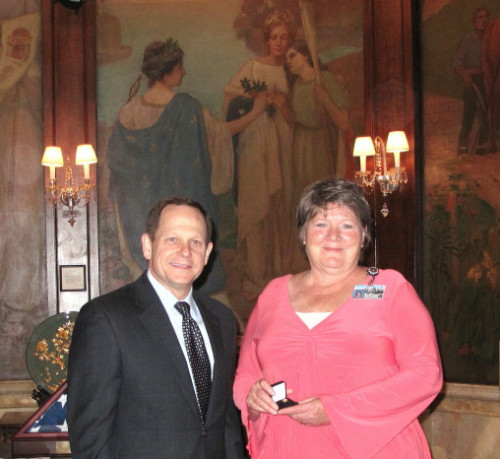 Mayor Slay presents 40-year pin to Linda Wessels