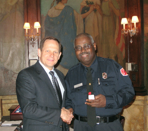 Mayor Slay presents Donald Jones with his 40-year service pin
