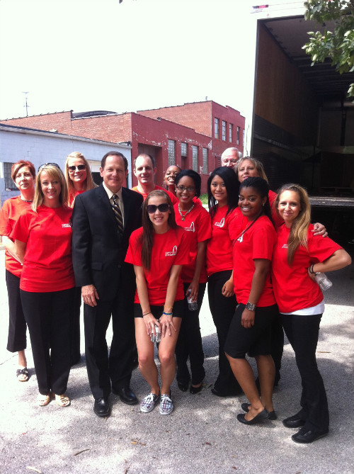 Mayor Francis G. Slay poses with Lumiere Place team members at AmeriCorps St. Louis.