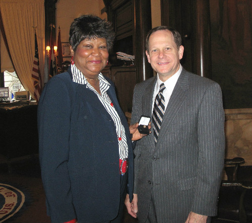Melinda Coburn and Mayor Slay 40 yr pin 121611