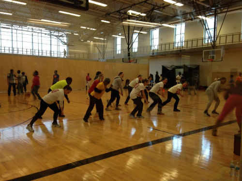 Ladies performing Zumba led by an instructor from The Dollhouse Studios at the O'Fallon Park Rec Plex.