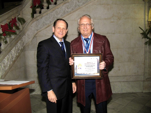 Mayor Francis G. Slay presents a Mayor's Service Award to Manfred Klatt of the Water Division.