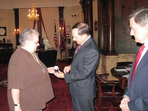 Carol Sears receives her 40 year service pin from Mayor Francis G. Slay as Assessor Ed Bushmeyer looks on 041511