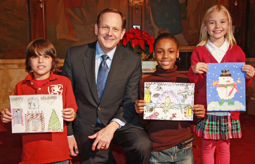Mayor Francis G. Slay poses with the top three finalists in his 2010 Holiday Card Design Contest.