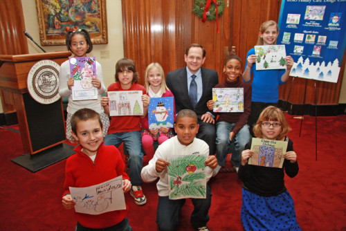 Mayor Francis G. Slay poses with the finalists in his 2010 Holiday Card Design Contest.