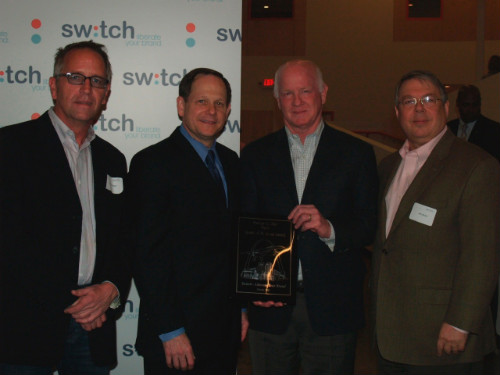 Mayor Francis Slay presents Spirit of St. Louis Award to officials from Switch.